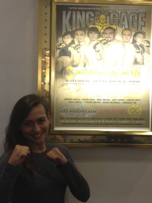 Julia with King of the Cage poster.